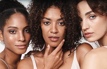 Close up beauty portrait of three attractive young sensual multiethnic women.