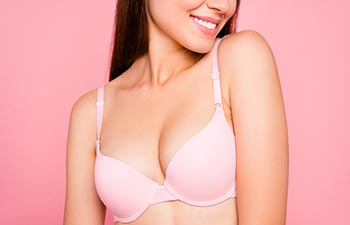 Close up portrait of girl wearing pink bra.
