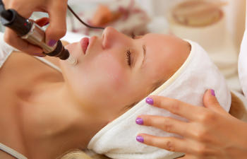 woman during facial treatment